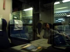 un libro per il viaggio (fotomie2009) Tags: treno libro train reflections riflessi textured fotosketcher viaggio book travel