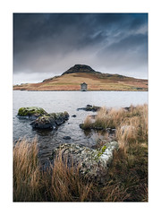 The Little House on the Lake No.2 (Dave Fieldhouse Photography) Tags: devoke devokewater lakes lakedistrict nationalpark cumbria portrait winter weather dull bleak moody water rocks grasses clouds boatshouse fujixt2 fujifilm fuji wwwdavefieldhousephotographycom