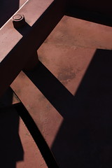 A small part of a large red sculpture - #2 (Jon Dev) Tags: shadows angles diagonals metal