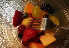 Fruit Challenge (Corgibird) Tags: fruit sexyfruit lowlight blackberries raspberries grapes cantalope shadows shadowslight foodporn seasonal fork metalfork blueberries fruitsalad