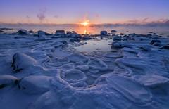 The First Rays (tinamar789) Tags: sunrise seasmoke sea seashore snow winter ice icy freezing frost frozen rocks sunray cold mist morning fog lauttasaari helsinki finland