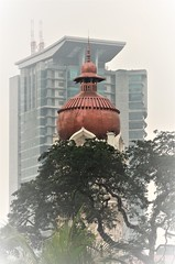 of different eras (2) (SM Tham) Tags: asia southeastasia malaysia kualalumpur klcolonialwalk sultanabdulsamadbuilding clocktower dome copper bukitaman policeheadquarters tower old new tree architecture building