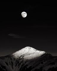 replacement (chris.regg) Tags: moon fullmoon mountains mountaintop alps swissalps sunset newyearseve grisons furna switzerland hiking landscape bw blackwhite blackandwhite monochrome