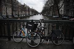 (Marwanhaddad) Tags: amsterdam bikes river winter bridge bicycle
