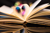 Let the fantasy play with your heart (Theo Crazzolara) Tags: book reading heart love buch liebe herz lesen library bücherei fantasy bokeh macro lights colorful colour secret romance romantic