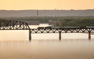 LIRC J12A crossing bridge at sunset
