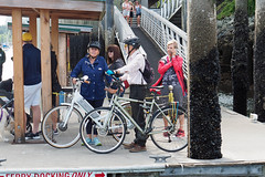 Waiting for the Water Taxi (PDX Bailey) Tags: people candid bike bycicle street bc columbia british canada red white blue phone man woman