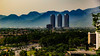 Urban Jungle (Mansoor Bashir) Tags: islamabad pakistan cityscape city urban landscape mountains hills skyscraper skyline highway infrastructure canon 6d trees buildings green blue