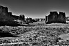 Sandstone Fins and Walls Across a Utah Desert (Black & White, Arches National Park) (thor_mark ) Tags: anseladamslookfromcapturenx2 archesnationalpark azimuth322 blackwhite blueskies canvas canyonlands capturenx2edited centralcanyonlands colorefexpro coloradoplateau courthousetowers day6 desert desertlandscape desertmountainlandscape desertplantlife highdesert intermountainwest lasalmountainsviewpoint landscape largebushes layersofrock lookingnw nature nikond800e outside portfolio project365 rockformations sandstonecanyonwalls sandstonefin sandstonewalls sheeprock sunny theorgan threegossips towerofbabel trees utahhighdesert utahnationalparks2017 ut unitedstates