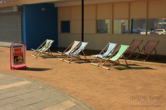 Stripes (innpictime ζ♠♠ρﭐḉ†ﭐᶬ₹ Ȝ͏۞°ʖ) Tags: beach greatyarmouth norfolk promenade seaside summer sunshine jetty hut leisure stall walls 526023671737619 deckchairs hire £2 stripes swingingsign