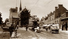 High Street, Barnet (footstepsphotos) Tags: barnet highstreet tram london hertfordshire waggon wagon bicycle people church road shop store berrill bazaar old vintage photograph past historic