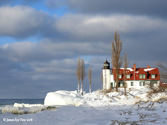 Winter Spotlight (JamesEyeViewPhotography) Tags: pointbetsie sky lighthouse clouds snow ice winter trees water waves lake michigan lakemichigan greatlakes february landscape nature northernmichigan jameseyeviewphotography