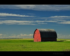 The hay is in the barn (Gordon Hunter) Tags: red barn green field blue sky clouds idyllic prairies country rural farming ab alberta canada gordon hunter nikon d5000 summer color colour simple shadow