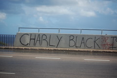 CHARLY BLACK (Midnight Believer) Tags: montegobayjamaica charlyblack graffiti tagged vandalism roadside roadway caribbean westindies island
