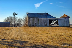 Between-186694 (rjmonner) Tags: windmill barn iowa farmstead farm machineshed agricultural farming rural relic relics decay neglected path lane midwest cornbelt blades windpump roof rust damage wednesday windmillwednesday blue bluesky winter brown golden trees