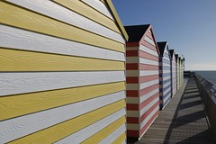 Beach Huts on Hastings Pier.... (markwilkins64) Tags: stripes texture uk eastsussex hastings hastingspier pier beachhuts colourful shadows canon leadinglines seaside seasidetown sea perspective lines colours