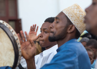 Sunni muslim men playing tambourines during the Maulidi festivities in the street, Lamu County, Lamu Town, Kenya