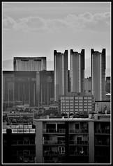Hazy (VegasBnR) Tags: nikon nevada sigma vegas vegasbnr vacation geografics geo gimp city building buildings bw blackandwhite skyline haze regancy regancytowers