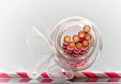 """In the bottle (Mazzlo) Tags: macro macromonday """"in bottle"""" bottle straws red white bow ribbon maureenlong mazzlo"""