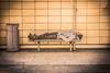 Sleeping it off (PaulJHopkins) Tags: homeless sleeping street symmetrical abstract outdoor tiles bench rough urban urbandecay bristol
