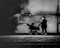 Mutter mit Kind... (hobbit68) Tags: mutter kind kinder mother children child kinderwagen wall mauer schienen blätter schwarzweis tennis graffiti
