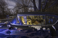 Broken Window Cool-Warm (Notley Hawkins) Tags: httpwwwnotleyhawkinscom notleyhawkinsphotography notley notleyhawkins 10thavenue night nocturne moonlight cadillac brokenwindow carwindow 2018 february missouri boonecountymissouri tree outdoors auto abandoned warmcool bluelight orangelight lightpainting light car windshield