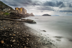 Contrasts in a stormy morning. (Emykla) Tags: beach sea mare spiaggia sassi rocks pozzuoli napoli campania italia italy clouds nuvole shore riva nikon d3100 storm tempesta teal