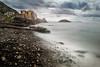 Contrasts in a stormy morning. (Emykla) Tags: beach sea mare spiaggia sassi rocks pozzuoli napoli campania italia italy clouds nuvole shore riva nikon d3100 storm tempesta teal