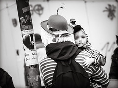 Gott.bleibt.God.stays (grizzleur) Tags: karneval olymplus omd olympusomdem10mkii omdstreetphotography bw mono monochrome blackandwhite street photography candid carneval kid child baby fetus hat blank stare god gott permanence stripes lines philosophy olylove candidphotography religion