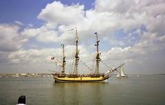 SailBoston1992 Ship HMS Rose BostonMA 7-11-1992f (ironmike9) Tags: sailboston1992 bostonharbor bostonma sail port harbor waterfront channel nautical maritime hmsrose frigate clouds