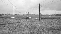 Saltholme area Teeside (35mm disjointed) Tags: teeside lead lines tufts water lake pond fence chemical industry man made transmission line electrical pylon texture