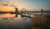 Sunset at Kinderdijk (reinaroundtheglobe) Tags: kinderdijk nederland zuidholland holland dutch dutchlandscape netherlands thenetherlands sunset water reflections waterreflections windmill traditionalwindmill mill traveldestination touristdestination