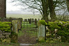 Biggin by Hartington (Blue sky and countryside) Tags: church gate limestone dry stone walls cold winter churchyard graves snowdrops derbyshire england pentax oldgate