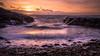 Sunset over the city - Dublin, Ireland - Seascape photography (Giuseppe Milo (www.pixael.com)) Tags: longexposure howth beach landscape sunset ireland pink cityscape dublin sky seascape clouds rocks orange sea countydublin ie onsale