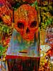A Coin for the Ferryman (Steve Taylor (Photography)) Tags: charon ferryman coin donation art digital sculpture colourful rust uk gb england greatbritain unitedkingdom london texture box cemetry graveyard skull southwark unionstreet