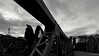 Two on the bridge (frankdorgathen) Tags: bridge people perspective wideangle monochrome blackandwhite sunset sky cloud köln cologne rheinland urban town city railing