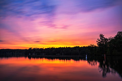Pink Sky (Matt Molloy) Tags: mattmolloy timelapse photography timestack photostack movement motion colourful sky sunset clouds pink purple yellow water reflection trees haskinspoint littlecranberrylake seeleysbay ontario canada landscape nature countryside lovelife