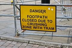 Crushing Zone, Manchester, UK (Robby Virus) Tags: manchester england uk unitedkingdom britain greatbritain danger footpath closed due crushing zone sign signage caution warning dangerous train rail car trolley tracks