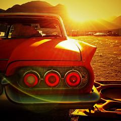 Thunderbird Sunshine (Maureen Bond) Tags: maureenbond ca thunderbird tbird red sun shine light flare tailight chrome hood brokenglass mountains junkyard trunk rearviewmirror iphone hss