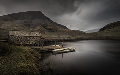 Gloom (jellyfire) Tags: cwm distagont3518 landscape landscapephotography mountains rain rhyddu winter ze zeissdistagont18mmf35ze atmospheric boathouse boats brown gloomy grey lake leeacaster moody ochre snowdonia tree wales wwwleeacastercom zeiss