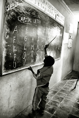 in the classroom (Neal J.Wilson) Tags: school boy blackandwhite bnw classroom learning teaching alphabet blackboard ethiopia ethiopian africanboy africa african abc tigray schoolchildren
