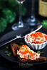 Salmon pate  with red caviar served with sliced bread (Katty-S) Tags: smoked salmon fish pate rillettes soft cheese spread mousse cream creamy red caviar dill bread slice sliced appetizer starter gourmet delicious dish herb snack toast wine glass food butter knife dark homemade recipe