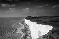 Belle Tout Lighthouse (Lloyd Austin) Tags: nikon d7200 sigma1750mm waves tide monochrome mono bnw blackwhite bw scenic walking people lighthouse sky clouds seascape landscape rocks stones sand beach coastline coastal coast water sea cliffs chalk southdowns englishchannel england eastsussex eastbourne beachyhead belletoutlighthouse