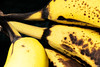 A Little Too Ripe? (iecharleton) Tags: macromondays macro banana fruit food speckled ripe rotting bunch blackbackground eat tropical