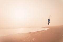 Flying away (ashercurri) Tags: nc beach ocean atlantic water obx outer banks sun fog foggy mist sony a7ii golden hour umbrella north carolina