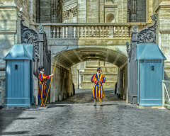Pontifical Swiss Guard Vatican City, Rome (Daveyal_photostream) Tags: swissguard pontificalguard swiss rome italy igitaly vaticancity vatican vaticancityrome nikon nikor travel vacation meandmygear mygearandme mycamerabag motion movement guards d600 photoshop lightroom nik military guarding papal architecture building men people gate irongate railing arch hdr hdrphotography hdrphoto catholic religion stpeters basilica guardhouse gateguards uniforms lance nicepants bodyguards shadows lightanddark highdefinition holysee