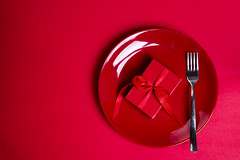 red gift box on red plate. (lyule4ik) Tags: plate ribbon background bow celebration abstract christmas knife fork curled decoration design holiday party red set symbol gold empty isolated award banner birthday blank corner curved decor element flag gift tag accessories place shape object line shiny concept tableware lunch present multitude steel decorated ornament metal goldware sale