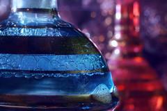 The mystery of Hammām. In a bottle. (Gudzwi) Tags: orientalischesbad türkischesbad hammām orientalbath turkishbath flasche bottle schaum soapfoam seifenschaum wasser water mm hmm macro makro macromondays macroorcloseup macromonday glas glass backlight gegenlicht bokeh blau rot gold unschärfe blur blue red redandblue rotundblau inabottle ineinerflasche luxus luxery duftessenz fragranceessence vollbad bath totakeabath einbadnehmen bad macromondaysfebruary12inabottle mystery mysterium