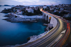 Blue hour trails (Lolo_) Tags: marseille longexposure sea bridge dusk lighttrails france malmousque corniche valmer kennedy jfk bluehour poselongue seaside street road anse faussemonnaie