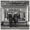 What shall we buy? (zapperthesnapper) Tags: ambleside street streetscene people shop building blackandwhite monochrome mono sonycybershot sonyrx10 sonyimages